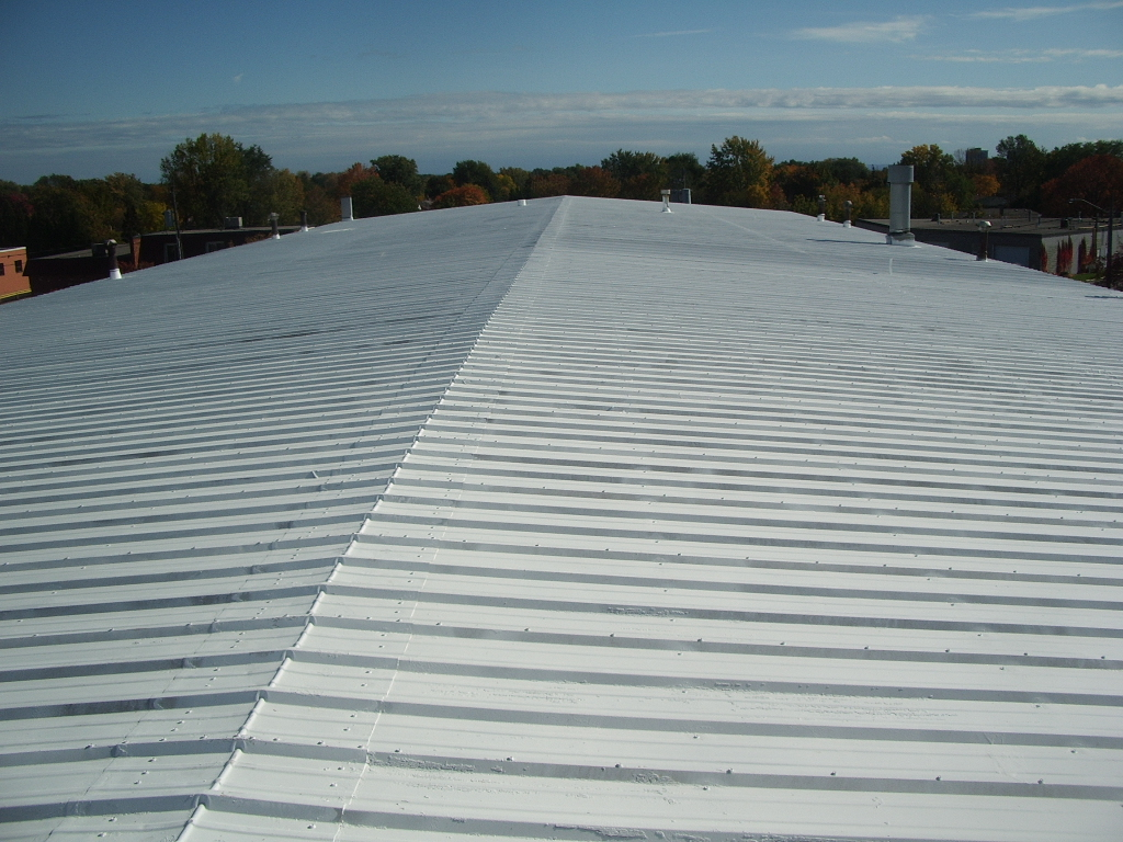 Elastomeric Roof Coating - Denver Commercial Roofing Contractor - Fluid Applied Roofing